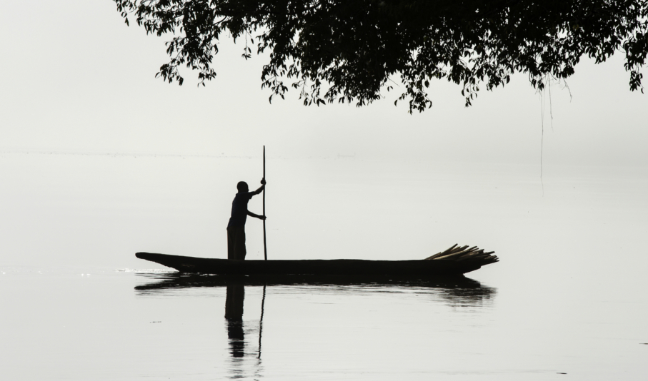 silhouette of a fisherman in the morning fog, congo river b